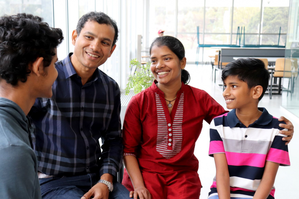 Scholar Malaka Perera from Sri Lanka with his wife and sons